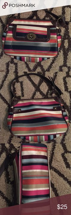 Coach handbag/cosmetic bag multi colored ❤️Preloved❤️Coach handbag/cosmetic bag Beautifully multi color (pink orange navy blue line green) bag with dark brown handle gold hardware✨✨✨ It does show some signs of wear mostly on the bottom👀See picture above. Does this bag fit your style???😉 Coach Bags Mini Bags