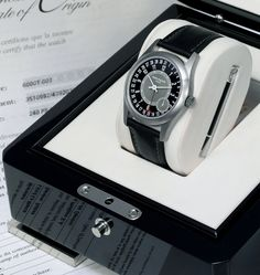 Patek Philippe Calatrava 6000T. In 2008 it was sold at an Antiquorum auction for 208,500 Swiss Francs. Here is how the watch was presented for auction in March 2008 – with fitted box, Certificate of Origin, push pin and booklets.