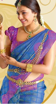 not a fan of this sari..but I like how she has it tied. puff-sleeve blouse looks cute. I like the jewelry too!