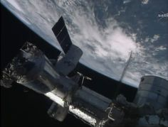 The SpaceX-3 Dragon cargo ship is seen attached to the International Space Station on April 20, 2014 for an Easter Sunday cargo delivery of 2.5 tons of food, supplies and gear for the orbiting lab's six-person Expedition 39 crew.