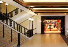Nulty Bespoke - Harrods, Art Deco Staircase - Polycarbonate Globe Light Fixtures Cast Iron Posts Historic Restoration