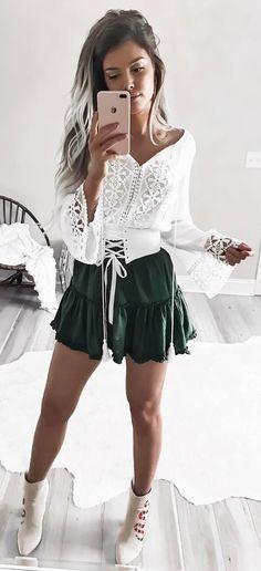 #spring #outfits  The Perfect Outfit To Twirl In 🐉 Get This Festival Look // White Lace Laced Up Blouse + Green Skirt + Light Printed Booties