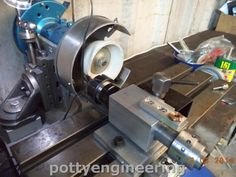 Cutter Grinder by sbwhart -- Homemade cutter grinder constructed from an off-the-shelf XY table and grinder. http://www.homemadetools.net/homemade-cutter-grinder-3