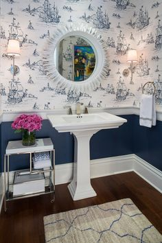 Powder Room Chair Rail design. Wall color is Benjamin Moore Newburyport Blue and the coastal wallpaper is by York Wallcoverings. Powder Room Chair Rail. Powder Room features Chair Rail, wallpaper and lowered wall painted in navy. #PowderRoom #ChairRail #ChairRaildesign Martha O'Hara Interiors