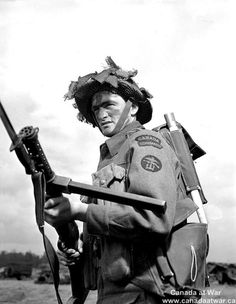Able Seaman Armand Therien of the Royal Canadian Navy Beach Commandos, England, 20 July 1944.