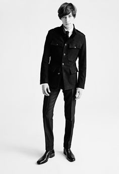 MEN'S AW15 LOOK 6 | Black bonded moleskin military jacket.  White poplin tab collar tailored fit barrel cuff shirt.  Black mohair twill mélange tailored frogmouth pocket 18cm tailored sport pants.  Black flat point silk knitted tie.  Black kidskin Lancaster boot.
