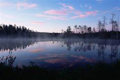 Reflections in lake at midnight, Kuhmo, Finland