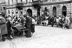 Warsaw, Poland, The market street in the ghetto. All would later be placed in cattle cars and taken to death camps, where most will meet their untimely death