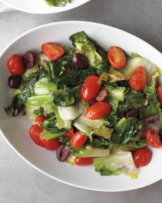 This easy side dish is winter's answer to the Greek salad. Lightly cooking the tomatoes and garlic sweetens their flavors, while wilting the…