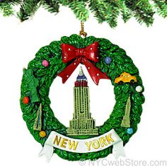 New York Empire Wreath Christmas Ornament 2.5 inch Empire State Building Christmas ornaments featuring additional NYC icons on the finely painted wreath such as the Statue of Liberty, Empire State Building, Chrysler Building and NYC Taxi. (http://www.nycwebstore.com/new-york-empire-wreath-christmas-ornament/)