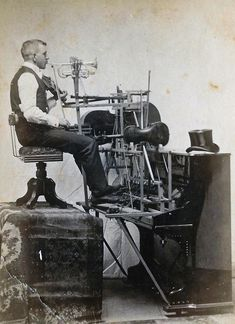 Late 1800s: One man band. Amazing. Wish I could have heard him play! And a beautiful top hat too...