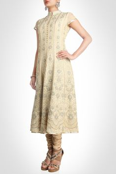 Manish Gupta collection | Churidar Kurta - Featured on panels of this kurta are embroidered intricate floral vine motifs and an elegant placket with loop pearls buttons. The delicate tissue overlayed panels are filled with these beautiful motifs that move into scallops towards the hem. The mesh dupatta is lined with variegated gold trim stripes running along its borders