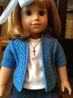 Ravelry: Briony– American Girl Antler Cable Cardigan pattern by Amanda Childs