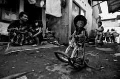monkey practices riding a wooden horse at Kampung Cipinang Besar in Jakarta