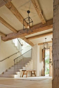 French farmhouse interior design inspiration flows from this magnificent architecturally stunning entry with natural rustic antique beams double doors stone steps and delicate wrought iron railing. The palette is quiet and the mood is naturally elegant. Rustic Doors, Home, Farmhouse Interior Design, Rustic House, House Design, French Farmhouse, New Homes, Farmhouse Interior, Rustic Entryway