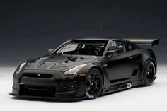 Matte black tricked out Nissan GTR. Body kit, spoiler and a custom hood.