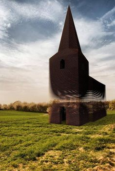 """Belgian architect group,Gijs Van Vaerenbergh, built a church in Belgium, and it's pretty plain...from certain angles.From others, the structure reveals itself to be something else entirely - a building that's almost entirely see through. The project, named """"Reading Between the Lines,"""" is a composition of 100 layers of stacked steel, that are equidistantly staggered in a way that illusively change in appearance based on where the viewer is standing."""