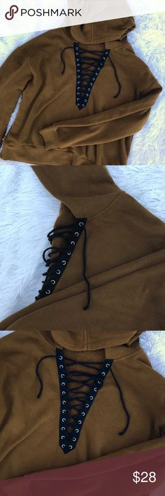 Lace-up Hoodie Previously loved💕 Great condition!!  Very clean.   Make me your best offer! ✨📦  • Please ask all questions prior to purchase • Bundle and save • Feel free to make an offer! All reasonable offers will be considered • All orders are are guaranteed to be clean, steamed and shipped with care 📦💌🛍 Tops Sweatshirts & Hoodies