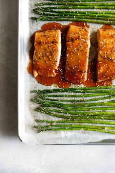 Easy oven Baked Sesame Glazed Salmon and Asparagus made on one pan with a sweet and savory Asian glaze that will make you swoon! This healthy, 30 minute meal is the perfect solution for busy weeknights. Sesame Salmon Recipe, Baked Salmon Recipes, Baked Asparagus, Salmon And Asparagus, Shellfish Recipes, Seafood Recipes, Good Healthy Recipes, Vegetarian Recipes, Healthy Eats