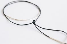 <p>Wrap it once, wrap it twice, tie it in the back or front—this sleek necklace, with its navy leather cord and silver arc, can be worn so very many ways. Go ahead and channel an angsty <em>Pulp Fiction</em> Uma Thurman on Friday, and do fresh-faced Hadid sister on Monday morning—look at you, keeping that jewelry all chill and easy.</p>