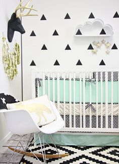 Black and white nursery ideas with accent colours in mint and gold.