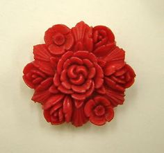Vintage carved floral red celluloid button
