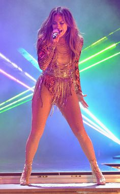 Jennifer Lopez commands the stage at Premios Juventud 2013 at the Bank United Center in Miami. #fashion