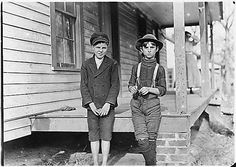 "CHILD LABOR: Reckon I been in mill 2 years. Don't remember."" Springstein Mill. John Lewis (boy with hat), 12 years old, 1 year in mill. Weaver — 4 looms. 40 [cents] a day to start, 60 [cents] a day now. Brother and mother in mill. Morris Small (boy with cap), ""Reckon I been in mill 2 years. Don't remember."" Chester, S.C., 11/28/1908 Series: National Child Labor Committee Photographs taken by Lewis Hine, ca. 1912"
