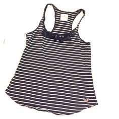 Hollister size small stripe tank Navy and white striped tank with flowers on top of neckline. Slight washer wear. Hollister Tops Tank Tops