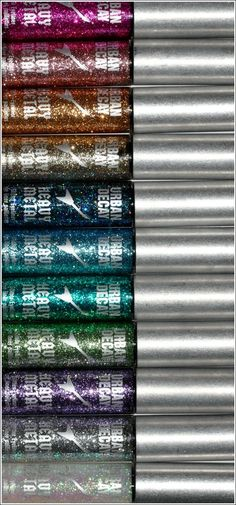 """Urban Decay Heavy Metal Glitter. My favorite is the gold one, """"Midnight Cowboy"""""""