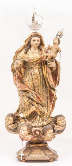 Imagem de madeira policromada, Nossa Senhora do Rosario. Bahia, século XIX. Alt. 37cm. Vendida por 4.000,00