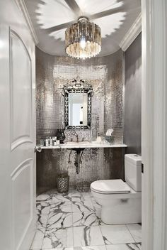 Traditional Powder Room with Crown molding, Bisazza JTC-1309 Bathroom Silver Glass, Complex marble counters, Pendant light