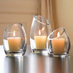 Beautiful glass candle holders for votives. Great for Candle Impressions wax finish votives... they won't dirty the candle holder with soot and wax.