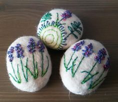 Wool-covered sea stone decorated with floral embroidery