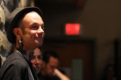 Dave McLauchlin smiles as he listens to Guelph Police Chief Bryan Larkin speak at the Harm Reduction Forum on Wednesday. McLauchlin was one of the youth featured in the Youth Voices video aimed at bridging the gap between at-risk youth and service providers.
