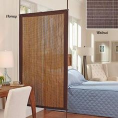 Diy hanging room divider from reed fencing diy for Hanging bamboo privacy screen