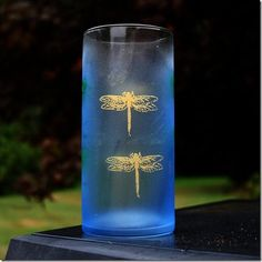 Glass painting... fireflies silkscreened on a dollar store vase.  Martha Stewart glass paints found at Michael's.