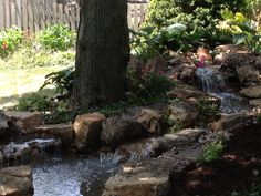 Waterfall and stream installed by Gem Ponds Naperville, IL