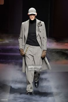 A model walks the runway at the Daks show during Milan Men's Fashion Week Fall/Winter 2018/19 on January 14, 2018 in Milan, Italy.