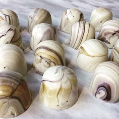 Beautiful Shell-like Bonbons by Pastry Chef & Chocolatier David H. Chow | Cracked Marble with veins of gold and black in the guise of OPALYS white chocolate bonbons.