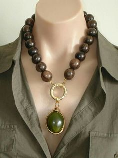 ASHIRA Ebony Wood Necklace with Khaki-Olive Green Tagua Ivory Nut Pendant Wire Wrapped in Brass * Handcrafted Jewelry by Ashira * This is a Bead Jewellery, Wire Jewelry, Jewelry Crafts, Beaded Jewelry, Jewelery, Jewelry Necklaces, Yoga Jewelry, Bracelets, Wood Necklace