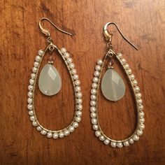 Earrings Only worn a few times. Middle stone is a very light green color Jewelry Earrings
