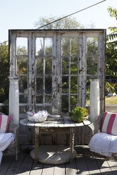 Old windows  other architectural details on a deck or patio area = A really neat idea!