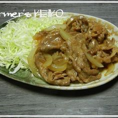 I stir-fried pork and onion with a lot of ginger and sweet and savoury seasonings. Serve with shredded cabbage and rice on the side!