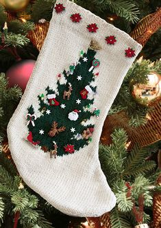 """Free Knitting Pattern for O Christmas Tree Stocking with Christmas Buttons - I love the idea of this stocking. Knit an intarsia tree and then decorate the stocking with button """"ornaments"""" and embellish with more buttons. Designed bySusie Bonell for Cascade Yarns."""