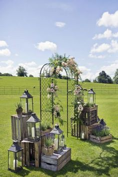 wooden crates wedding ideas metal arch decorated with flowers surrounded by boxes with lanterns mark tattersall photography