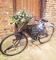 This old bicycle became both a wedding welcome sign and flower bouquet decor.