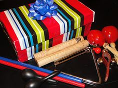 Birthday Box - My Birthday Box has a bunch of fun instruments in it for the birthday kids to play while we sing them a birthday song.    I decorated a shoe box (the hinge type that stays connected on one side) like a birthday present. Then I filled it with instruments I've collected from various places including toy stores, dollar stores and music stores.    The kids love to play the instruments and when we have a bunch of birthdays we have a 'Birthday Band!'