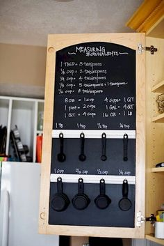 Hidden chalkboard  Every surface in your kitchen is an opportunity to add some extra storage and organization. Create your own chalkboards on the inside of your cabinets with chalkboard paint to write helpful notes and reminders. You can even add some hooks for additional utensil storage.