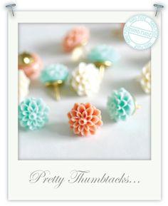 i've seen these used as earrings, but not thumbtacks! Cute idea!